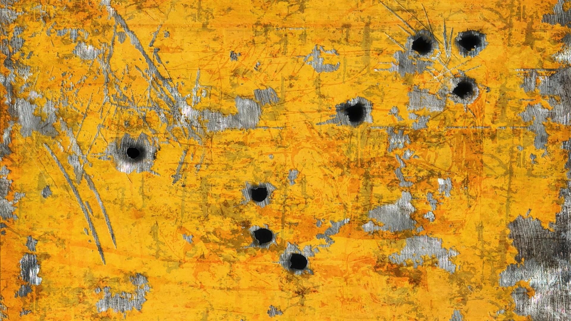 Hình nền màu vàng bức tường bị súng bắn