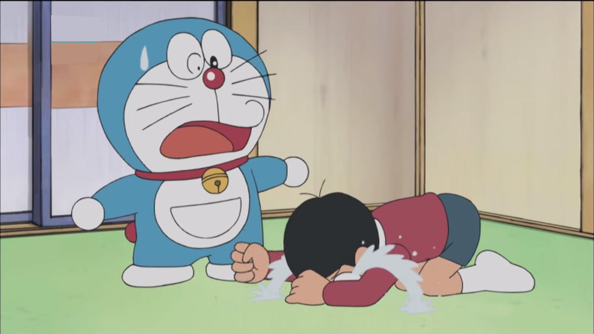 Hình ảnh Nobia buồn khóc bên Doraemon
